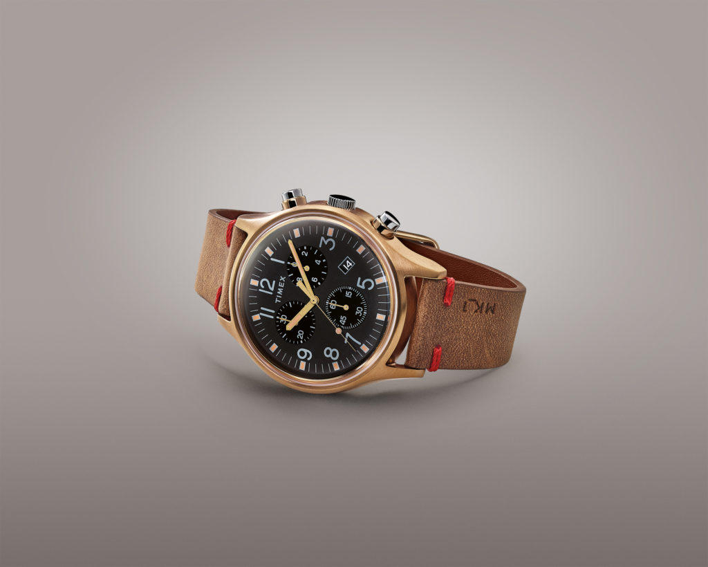 Gold MK1 with brown leather strap and black interior piece