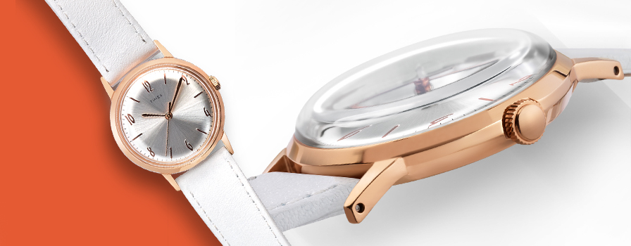 Rose Gold and White Leather Marlin Watch laying flat on right and zoomed in on face of watch on left