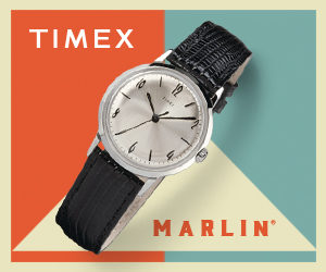 Silver Marlin watch with black leather straps in front of orange blue and tan background