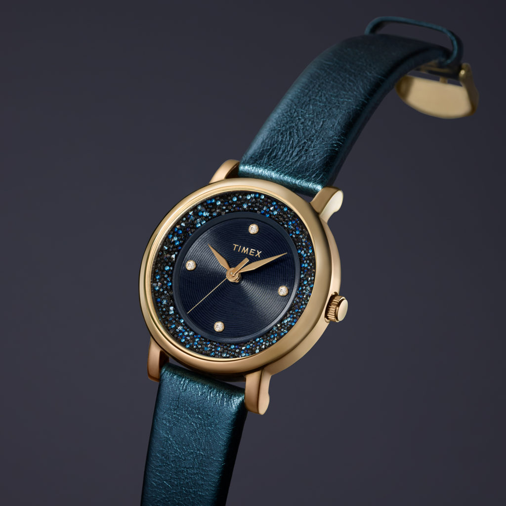 gold womens watch with dark green leather straps and shining crystals in the inner body of watch