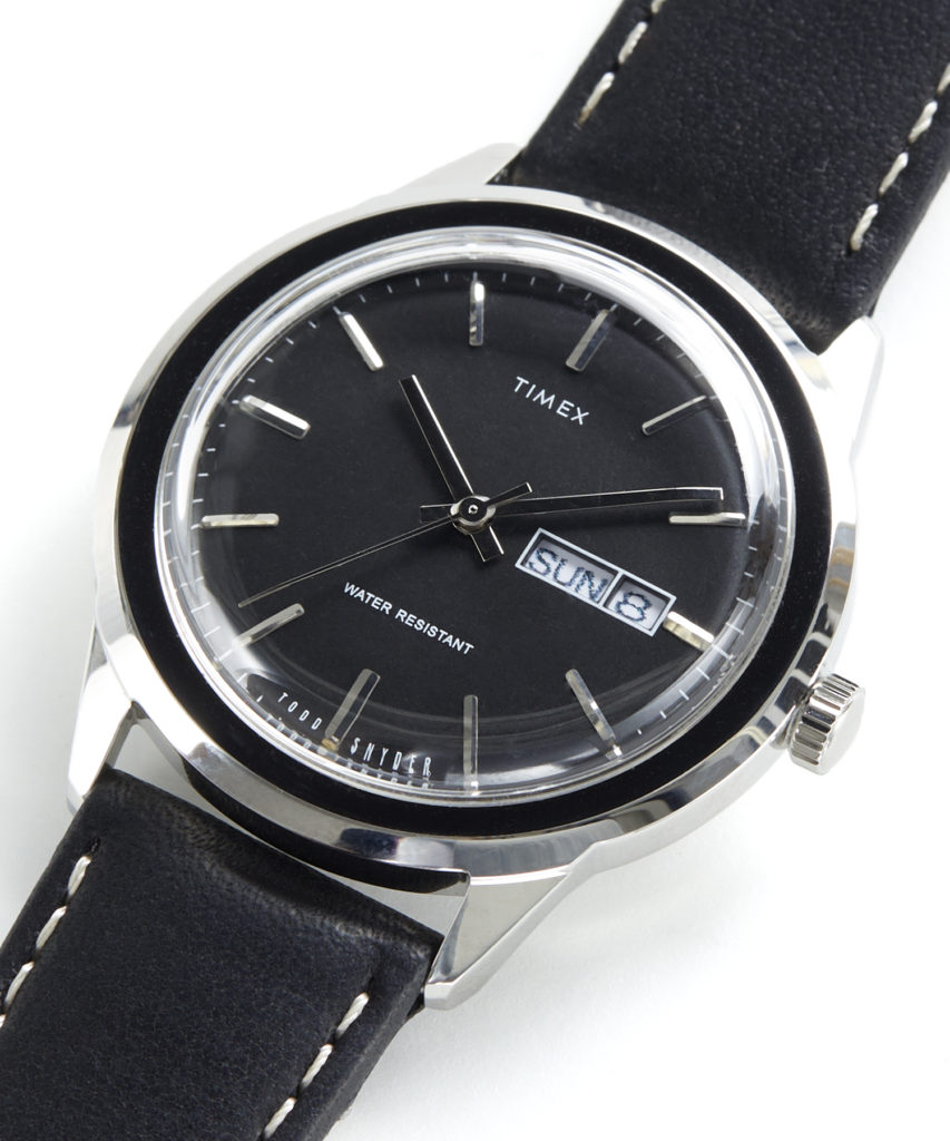 Silver Waterbury Timex Watch with black leather straps and silver dial